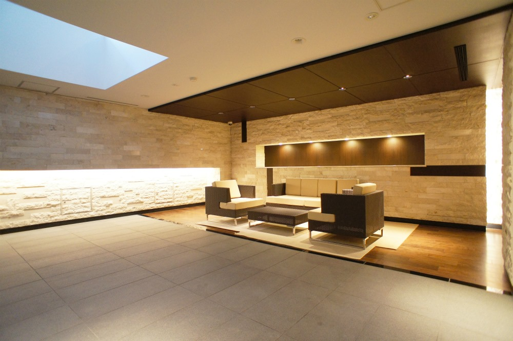 The entrance and lobby appears simple, but yet modern and stylish.